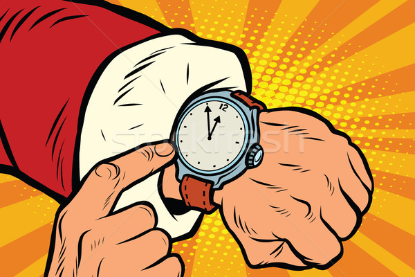 Santa Claus shows the clock, nearly midnight Stock photo © studiostoks