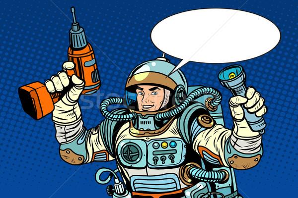 Astronaut with a drill and flashlight Stock photo © studiostoks