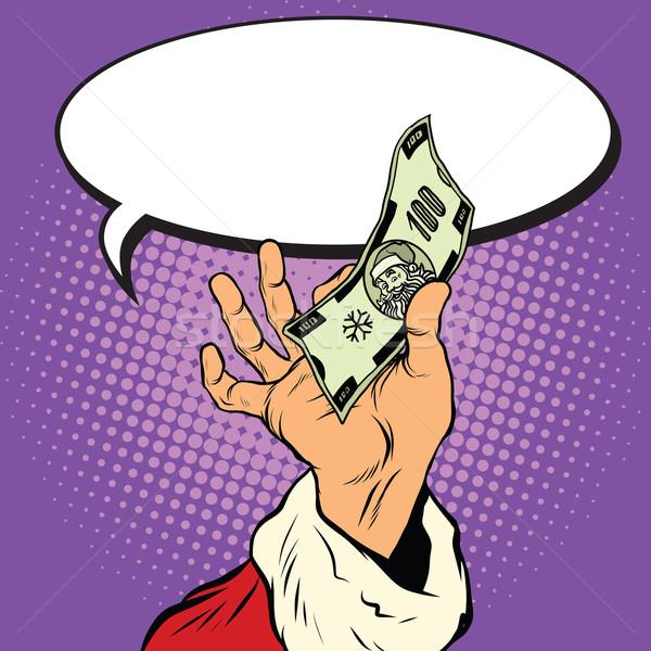 Mão papai noel natal dinheiro retro Foto stock © studiostoks