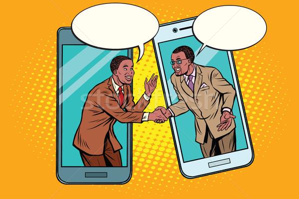 Online the talks of the two businessmen Stock photo © studiostoks