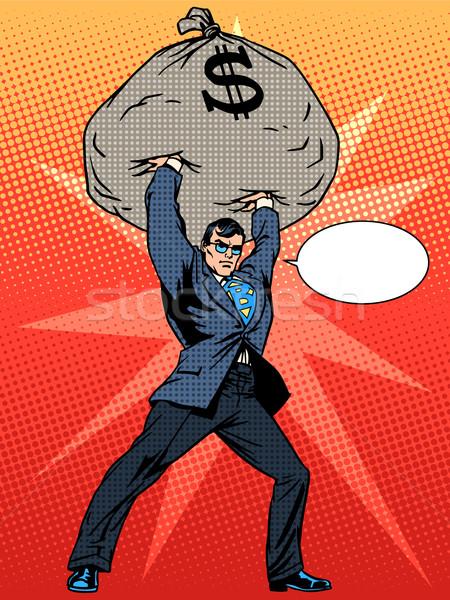Super businessman hero with a bag of money financial success Stock photo © studiostoks