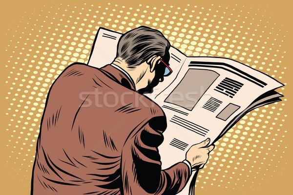 Businessman reading a newspaper Stock photo © studiostoks