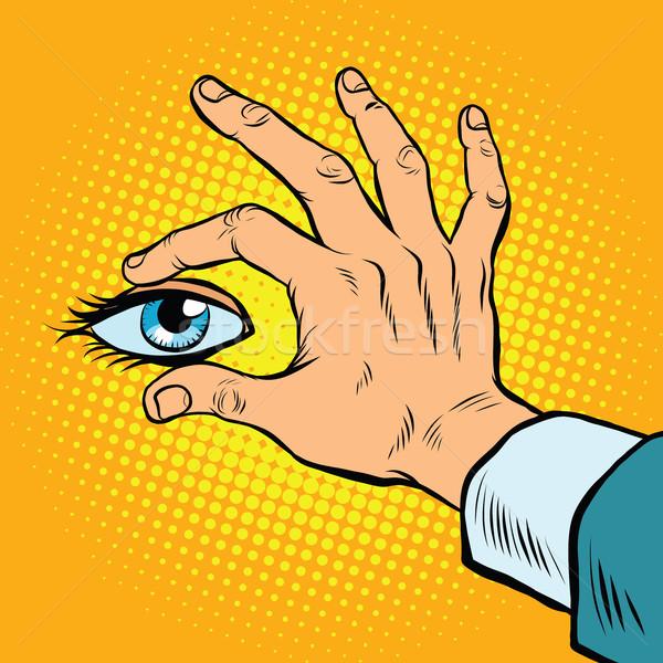 Retro hand holding eyes Stock photo © studiostoks