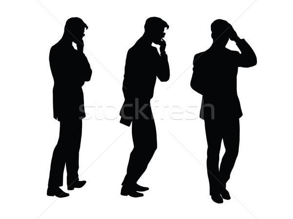 Male businessman thinks goes black silhouette figure Stock photo © studiostoks