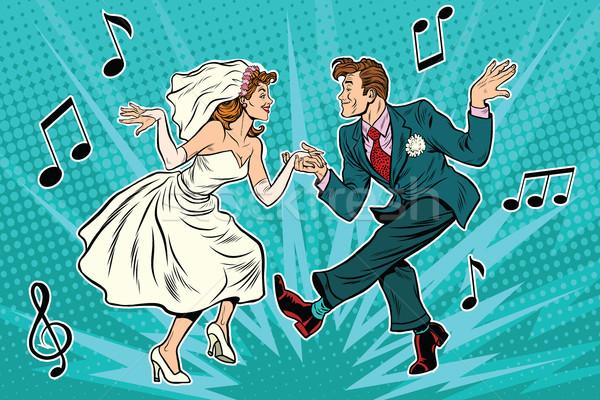 dancing bride and groom Stock photo © studiostoks