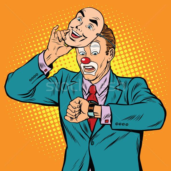 The clown looks at his watch Stock photo © studiostoks