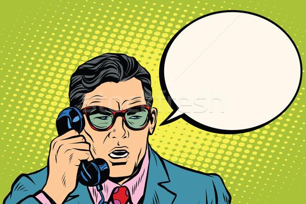 Surprise. Businessman talking on the phone Stock photo © studiostoks