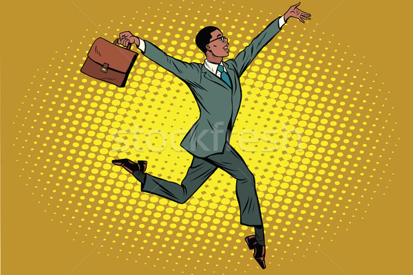 Elegant funny African businessman with briefcase running on tipt Stock photo © studiostoks