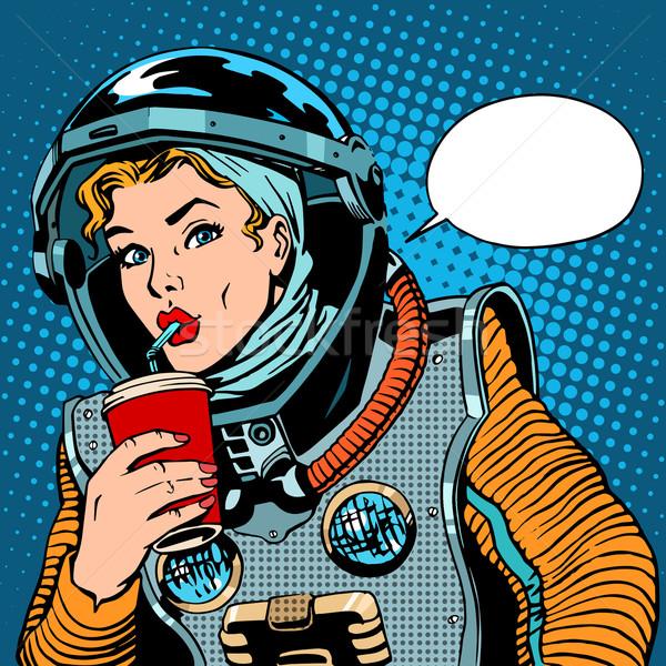 Vrouwelijke astronaut drinken soda pop art retro-stijl Stockfoto © studiostoks