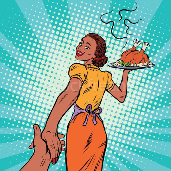 follow me African-American housewife with roast Turkey Stock photo © studiostoks