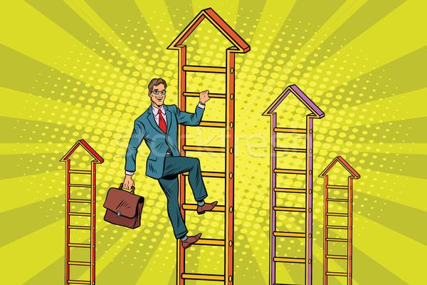 Businessman climbs up the stairs Stock photo © studiostoks