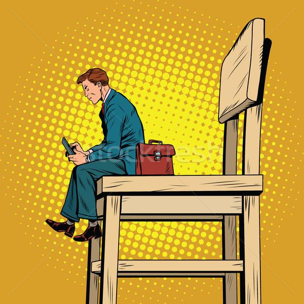 Kisvállalkozás férfi nagy szék okostelefon pop art Stock fotó © studiostoks