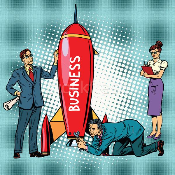 business startup, businessmen and businesswomen launch a rocket Stock photo © studiostoks