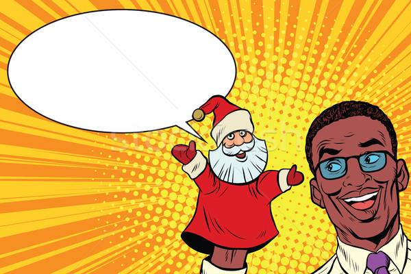 African businessman with hand puppet Santa Claus Stock photo © studiostoks
