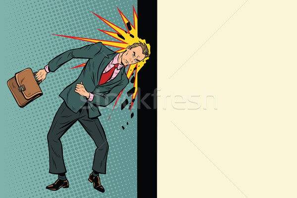 Businessman breaks the wall with his head Stock photo © studiostoks