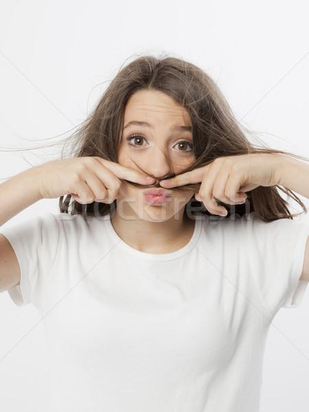 本当の 若い女の子 面白い ジェスチャー 少女 顔 ストックフォト © Studiotrebuchet