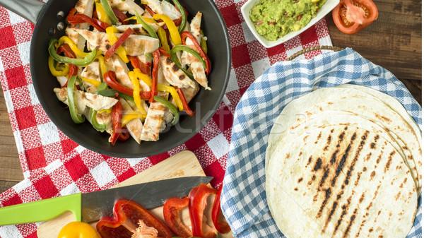 delicious wrap tortilla with spicy chicken vegetables guacamole Stock photo © Studiotrebuchet