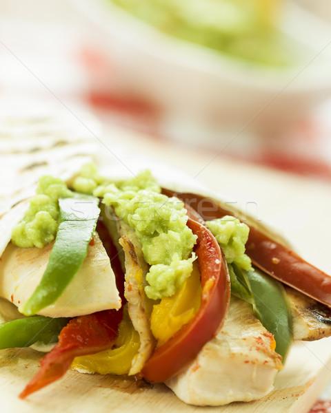 Finom csomagolás tortilla fűszeres tyúk zöldségek Stock fotó © Studiotrebuchet