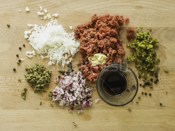 mixing steak tartare ingredients in a bowl Stock photo © Studiotrebuchet