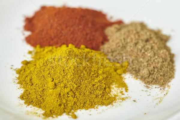 different spices paprika curry garam massala in white table Stock photo © Studiotrebuchet