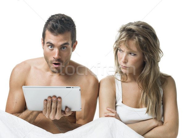 Stock photo: uncommunicative couple on bed in white