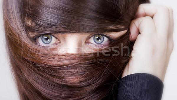 Nő haj körül szemek néz fiatal nő Stock fotó © Studiotrebuchet