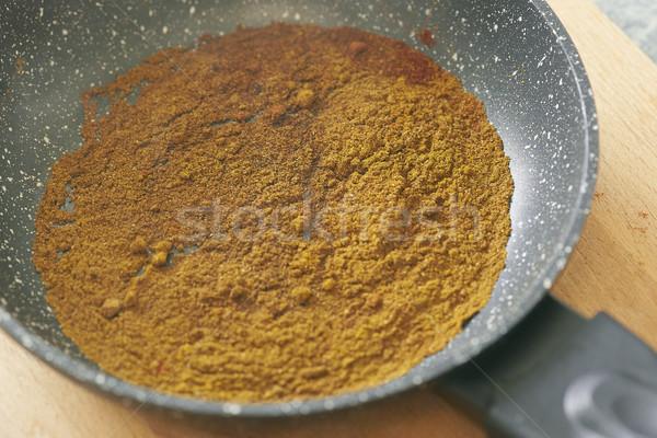different spices paprika curry garam massala in pan Stock photo © Studiotrebuchet