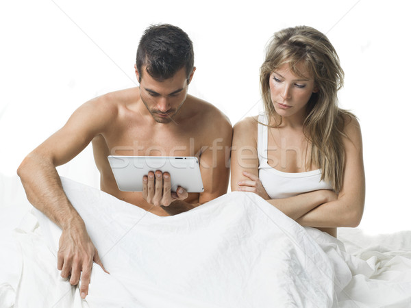 uncommunicative couple on bed in white  Stock photo © Studiotrebuchet