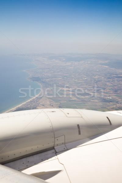 Vliegen vervoer vliegtuig venster vleugel Stockfoto © Studiotrebuchet