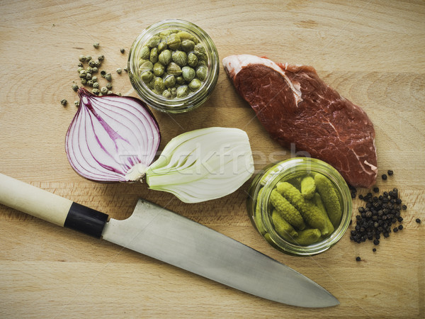 mixing steak tartare ingredients in a bowl Stock photo © Studiotrebuchet