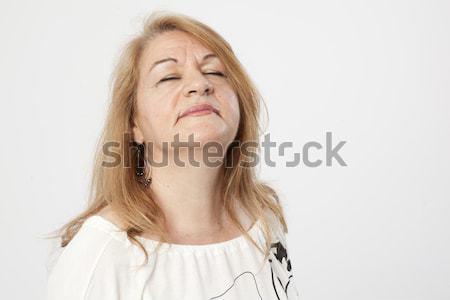 Senior vrouw denken ademhaling ontspannen vrouwelijke Stockfoto © Studiotrebuchet