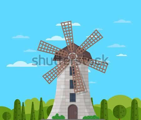 Vieux moulin à vent ciel bleu bâtiment nuageux médiévale Photo stock © studioworkstock