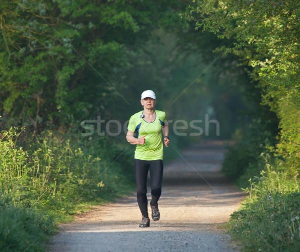 Idősebb nő fut képzés fut kora reggel Stock fotó © suerob