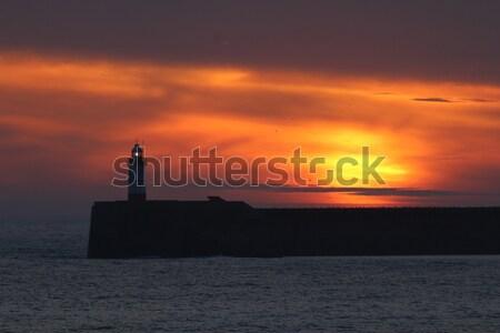 Gün batımı deniz feneri gökyüzü güneş deniz turuncu Stok fotoğraf © suerob