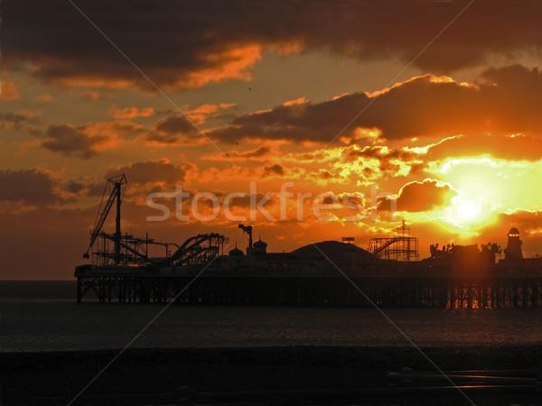 Pier coucher du soleil nuages sussex Angleterre soleil Photo stock © suerob