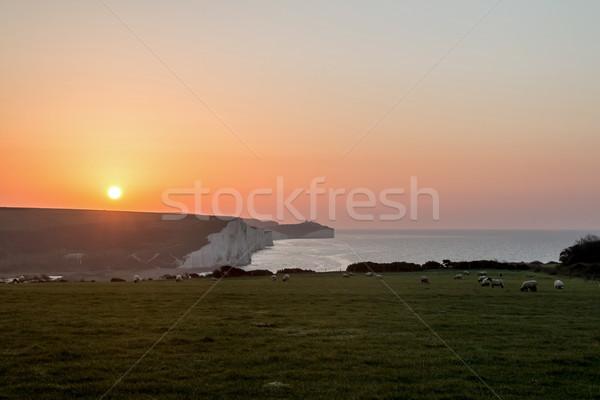Napfelkelte hét nővérek kréta sziklák égbolt Stock fotó © suerob
