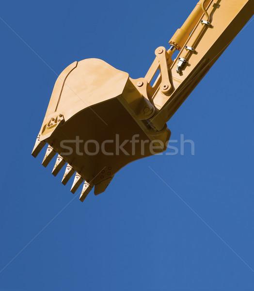 Escavadeira pá oposto blue sky trabalhar industrial Foto stock © Suljo