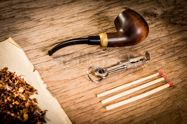pipe, tobacco, paper and matches on a wooden table Stock photo © superelaks