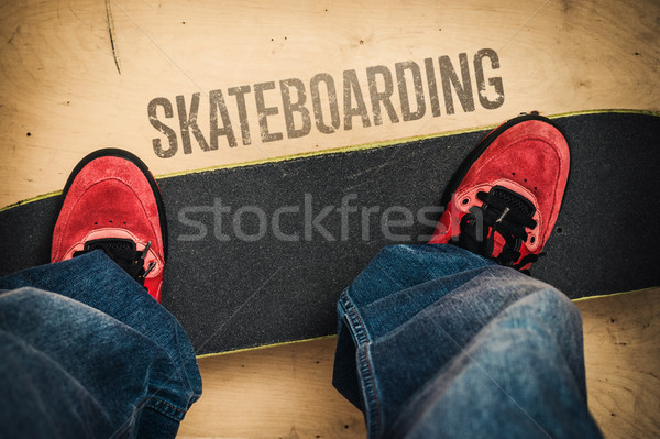 Skateboarding in skate park. Shoes and board Stock photo © superelaks