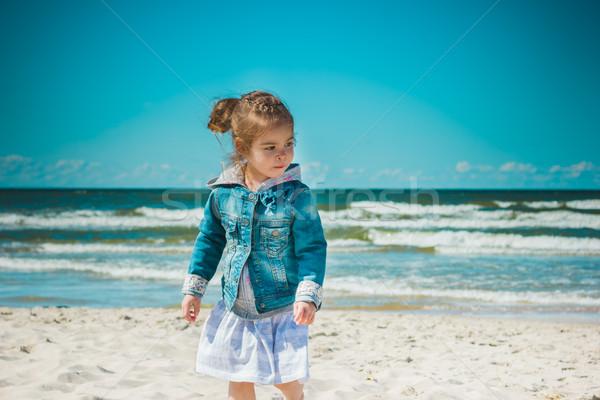 Sevimli küçük kız ayakta plaj tatil su Stok fotoğraf © superelaks