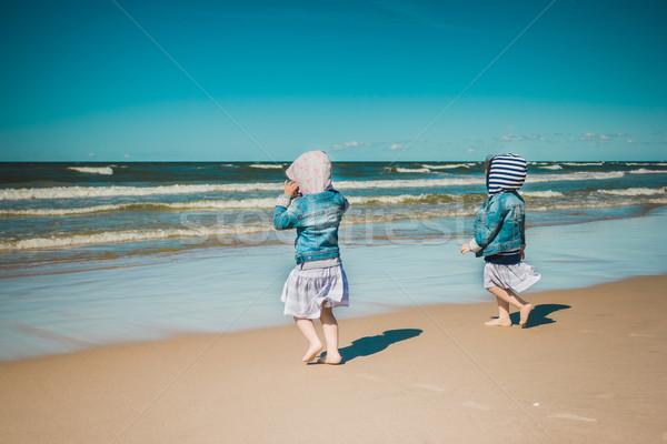 Iki deniz kızlar zaman sahil Stok fotoğraf © superelaks