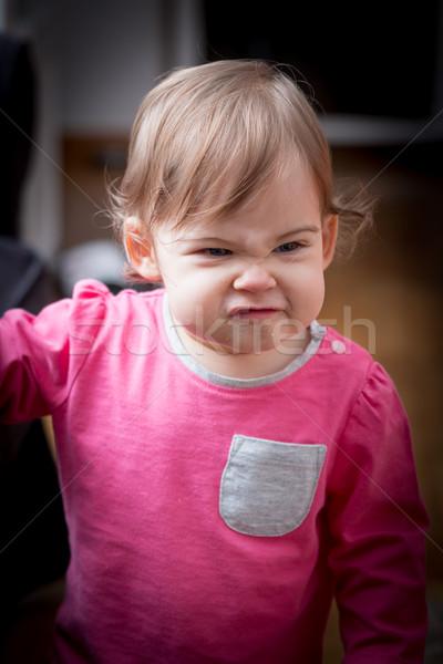 Dziewczynka funny twarzy cute różowy bluzka dziewczyna Zdjęcia stock © superelaks