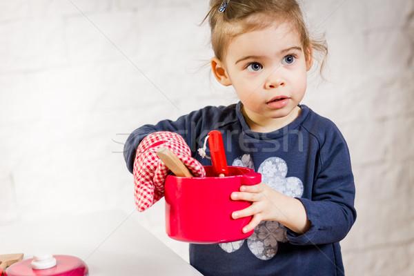 Küçük kız oynama oyuncaklar sevimli poz beyaz Stok fotoğraf © superelaks
