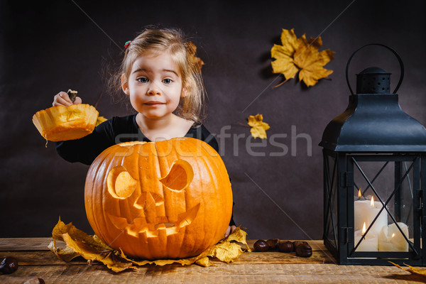 girl poses with a Halloween pumpkin Stock photo © superelaks