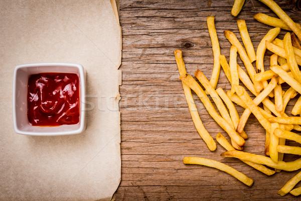 картофель фри кетчуп бумаги деревянный стол старые Сток-фото © superelaks