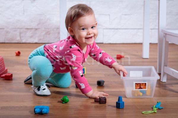 Kız oynama oda küçük sevimli gülümseme Stok fotoğraf © superelaks
