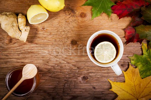 çay bal tablo sonbahar yaprakları eski ahşap masa Stok fotoğraf © superelaks