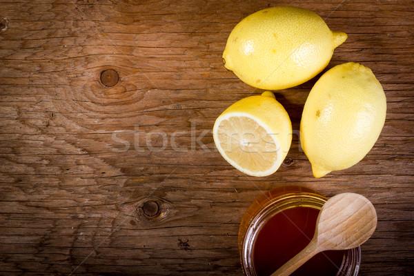 Limon bal ahşap masa taze eski gıda Stok fotoğraf © superelaks