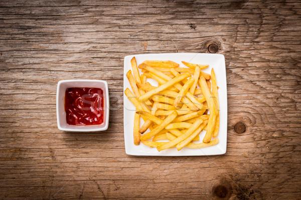 картофель фри кетчуп деревянный стол пластина старые фон Сток-фото © superelaks