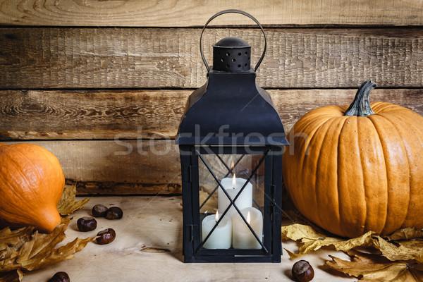 Lanterna zucca tavolo in legno halloween vecchio luce Foto d'archivio © superelaks